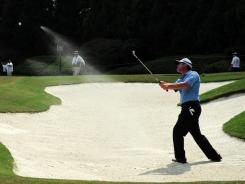 D.A. Points hits out of one of the many difficult bunkers at Atlanta Athletic Club.