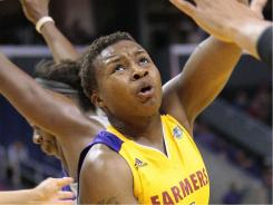 Angeles Sparks guard Natasha Lacy puts up a shot against the Phoenix Mercury during the second half Friday. The Sparks won 93-90.