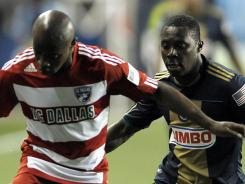 Jair Benitez of FC Dallas drives past Freddy Adu, right, who was playing his first game with Philadelphia on Friday night. Adu and the Union finished in a 2-2 tie with FC Dallas.