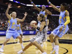 The Chicago Sky's Courtney Vandersloot, left, Michelle Snow, top center, and Tamera Young, right, converge on Silver Stars guard Becky Hammon (25) during Chicago's 85-73 win in San Antonio.