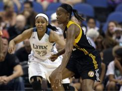 Sheryl Swoopes, right, driving against the Lynx's Maya Moore, and the Tulsa Shock lost their 17th consecutive game, falling to Minnesota 82-54 on Sunday.