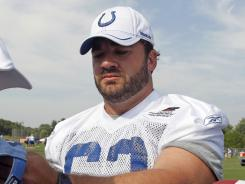 Jeff Saturday signs autographs Aug. 2 at Colts training camp in Anderson, Ind.