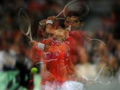 This multiple exposure shot of Novak Djokovic must be what he looks like to opponents these days.