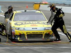 Race winner Marcos Ambrose makes a pit stop during Monday's 90-lap free-for-all at Watkins Glen.