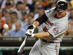 Jim Thome hits his 600th career home run Monday in the Twins' 9-6 win over the Tigers at Comerica Park in Detroit.