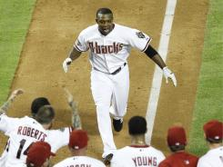 Diamondbacks' Justin Upton heads for home plate after hitting a walk-off home run against the Giants.