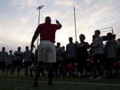 Red Lion Christian head coach Dwayne Thomas talks to his team following a recent practice.
