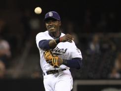 Padres' Orlando Hudson makes the off balance throw to get Diamondbacks' Justin Upton at first during a July 26 game.