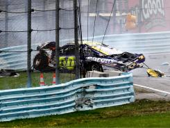 David Reutimann's car plows into a non-SAFER barrier in Monday's race at Watkins Glen International.