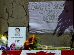 A makeshift memorial is displayed to honor former Canucks player Rick Rypien outside Rogers Arena in Vancouver.