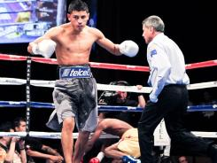 Abner Mares knocked Joseph Agbeko down in the first round, and again in the 11th round on a controversial low blow that ultimately caused the IBF to order a rematch of their bantamweight tournament final.