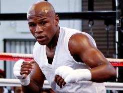 Floyd Mayweather continues to train for his Sept. 17 fight against Victor Ortiz despite legal problems outside the ring.