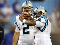 Carolina Panthers quarterback Cam Newton throws a pass as Jimmy Clausen looks on prior to their preseason game against the New York Giants on Aug. 13.