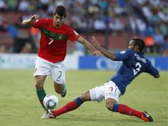 Portugal's Nelson Oliveira, left, dribbles past France's Chrys Mavinga during a U-20 World Cup semifinal soccer match in Medellin, Colombia, on Wednesday.