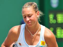 Yanina Wickmayer of Belgium has asked for an end to the investigation on whether she broke anti-doping rules.