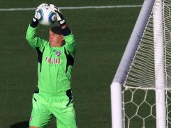 FC Dallas goalie Kevin Hartman makes a save against Chivas USA on July 31 in Frisco, Texas.