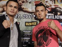 Robert Guerrero, right,  was looking to win a title in a third weight class vs. Marcos Maidana. His handlers fear he has a torn rotator cuff.