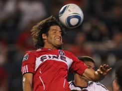 Sebastian Grazzini of the Chicago Fire attempts a head shot against D.C. United during the teams' 1-1 draw on Thursday in Bridgeview, Ill.