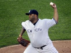 CC Sabathia pitched seven innings to lead the Yankees past the Twins and snap a personal two-game losing streak.