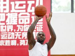 Lebron James plays basketball with Chinese fans during his Shanghai Tour on Thursday. The Chinese Basketball Association is not allowing contracted NBA players to participate in their league during the lockout.