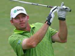 Tommy Gainey shot a 65 on Friday to move to 12 under at the Wyndham Championship at Sedgefield Country Club in Greensboro, N.C.
