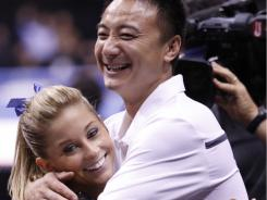 Shawn Johnson and coach Liang Chow hug after her balance beam performance during the Visa National Championships at the Xcel Energy Center in St. Paul on Thursday.