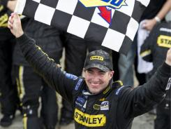 Stanley Ford driver Marcos Ambrose from Australia celebrates his victory at the  NAPA Auto Parts 200 NASCAR Nationwide race Saturday, in Montreal.