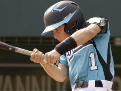 Warner Robins, Georgia's Logan Morris drives in two runs with a single in the fifth inning off Rapid City, S.D. pitcher Justin Kraemer during the Little League World Series in South Williamsport, Pa., on Saturday,