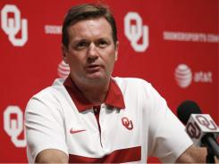 Oklahoma head coach Bob Stoops, seen at football media day in Norman, Okla. on Aug. 6, led his team to a 12-2 record in 2010. But the Sooners haven't won a national championship since 2000.
