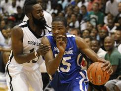 Oklahoma City Thunder teammates Kevin Durant, right, and James Harden faced off in summer league action. Durant and his Goodman League squad got the better of Harden and the Drew League team.