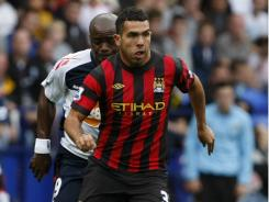 Manchester City's Carlos Tevez makes a run against Bolton during their English Premier League soccer match at Reebok Stadium in Bolton, England, Sunday.