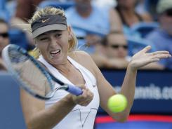 Maria Sharapova of Russia fires a forehand during her three-set victory Sunday against Jelena Jankovic of Serbia in the final of the Western & Southern Open.