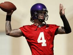 TCU quarterback Casey Pachall warms up during the first summer practice of the season on the TCU campus in Fort Worth, Texas, on Aug. 4.