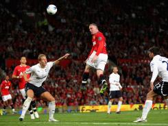 Rooney of Manchester United scores his club's third goal during the English Premier League match against Tottenham Hotspur.