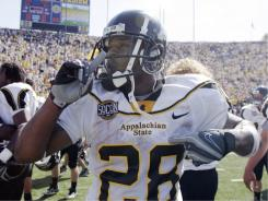 Former Appalachian State running back Kevin Richardson helped establish the school as a Football Championship Subdivision power. The team is weighing a shift to college football's top tier.