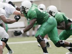 Marshall standout defensive end Vinny Curry is the C-USA preseason defensive player of the year.