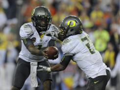 Quarterback Darron Thomas (1) and running back LaMichael James  lead an impressive group of returnees in the Ducks' offensive backfield.