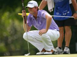 Webb Simpson lines up a putt with his long putter during his victory Sunday at the Wyndham Championship.