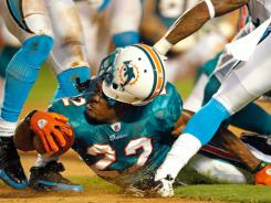 Miami Dolphins running back Reggie Bush loses his helmet during a preseason NFL game against the Carolina Panthers on Aug. 19.