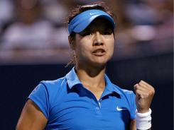 China's Li Na, winner of the 2011 French Open, celebrates beating Russia's Maria Kirilenko at the New Haven Open on Wednesday night.