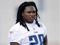 Tennessee Titans running back Chris Johnson takes a break during training camp in 2010.