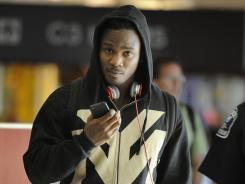 Tennessee Titans running back Chris Johnson arrives at Metro Nashville International Airport Aug. 23.