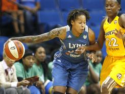 Seimone Augustus, left, had 12 points to help the WNBA-best Lynx drop the Shock to 1-24 on the season.