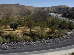 The pack rides during the fifth stage of the Spanish Vuelta cycling race over 116 miles from the start in Sierra Nevada to the finish in Valdepenas, Spain, on Wednesday.