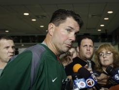 Miami football coach Al Golden talks to the media before practice Thursday. Miami awaits its football opener at Maryland while the university sorts out the eligibility of 15 athletes implicated in the scandal involving a booster who says he gave cash and gifts to players between 2002 and 2010.