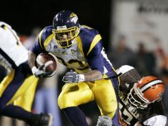 Quinton Broussard, here in a November 2005 game with Toledo, pleaded guilty in federal court to conspiracy to commit sports bribery.