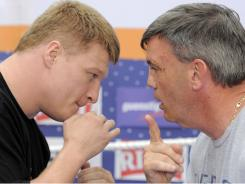 Alexander Povetkin of Russia, left, works with trainer Teddy Atlas in preparation for his fight Saturday against Ruslan Chagaev for the  WBA Heavyweight Title.