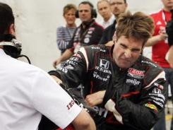 Will Power reacts after a crash knocked him out of the  MoveThatBlock.com 225 IndyCar race, Aug. 14, in Loudon, N.H.