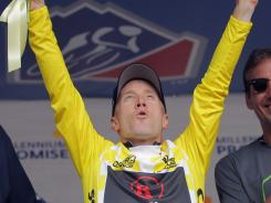 Levi Leipheimer of the USA riding for Team Radioshack celebrates as he takes the podium to recieve the overall race leaders jersey after winning the individual time trial during stage three of the 2011 USA Pro Cycling Challenge.