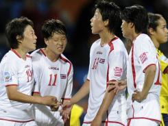 North Korean players react following the group C match between North Korea and Colombia at the Women's World Cup in Bochum, Germany, on July 6. The game ended in a 0-0 draw.